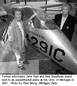 Former astronauts Jane Hart and Bea Steadman stand next to an experimental plane at the University of Michigan in 2001.</p>