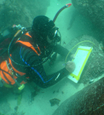 Stephen Lubkemann excavating a sunken Portuguese slave ship.