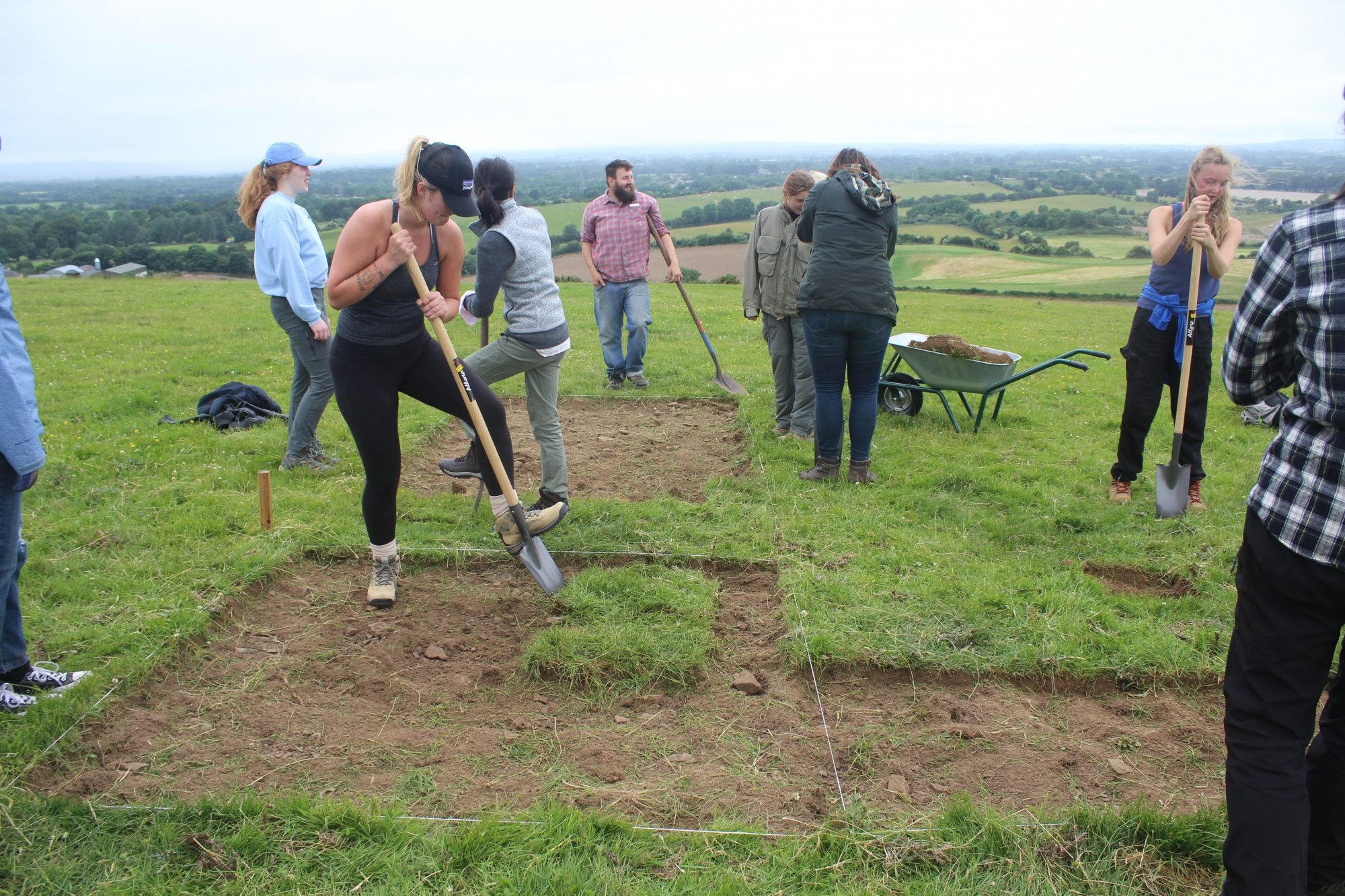 Students digging at an excavation in ireland