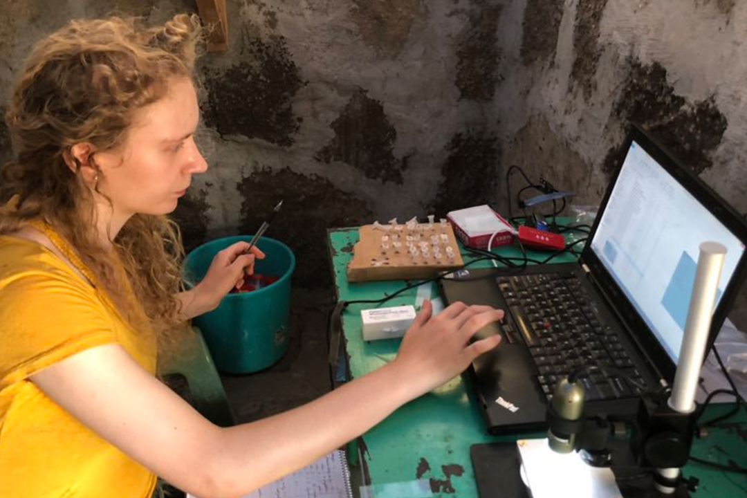 a student working with a laptop inside Koobi Fora school