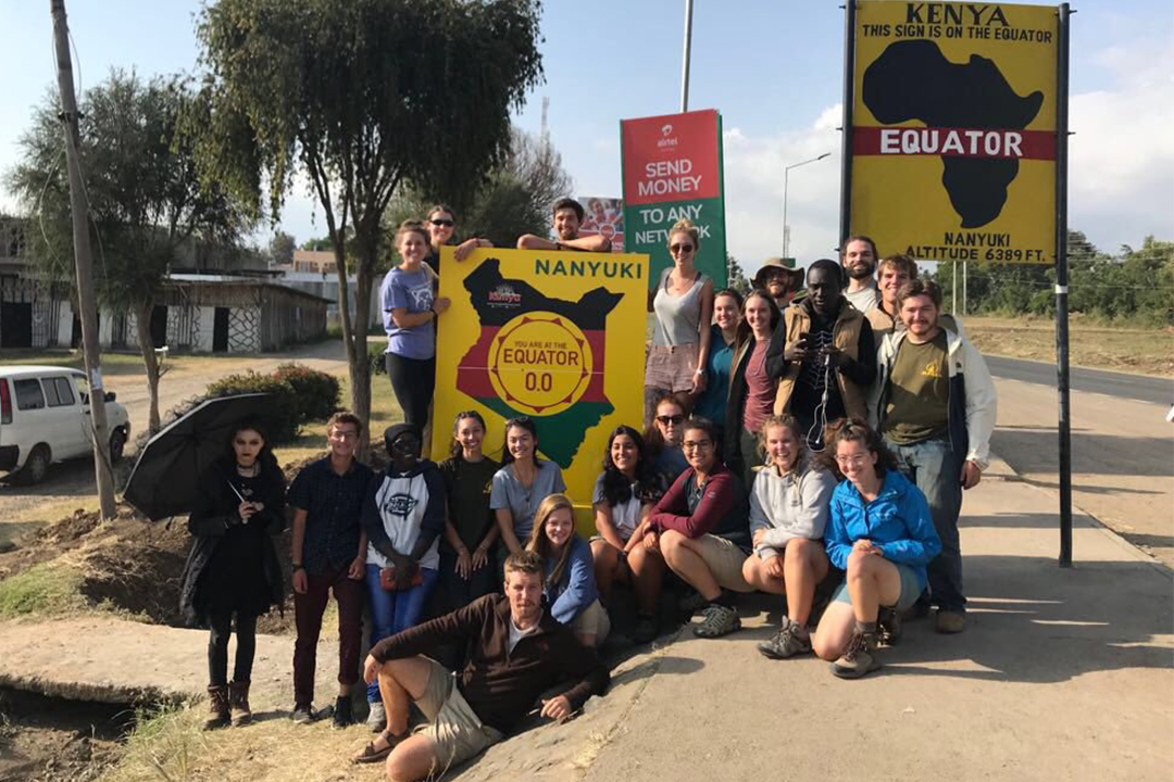 Anthropology faculty and students at the Kenya equator sign