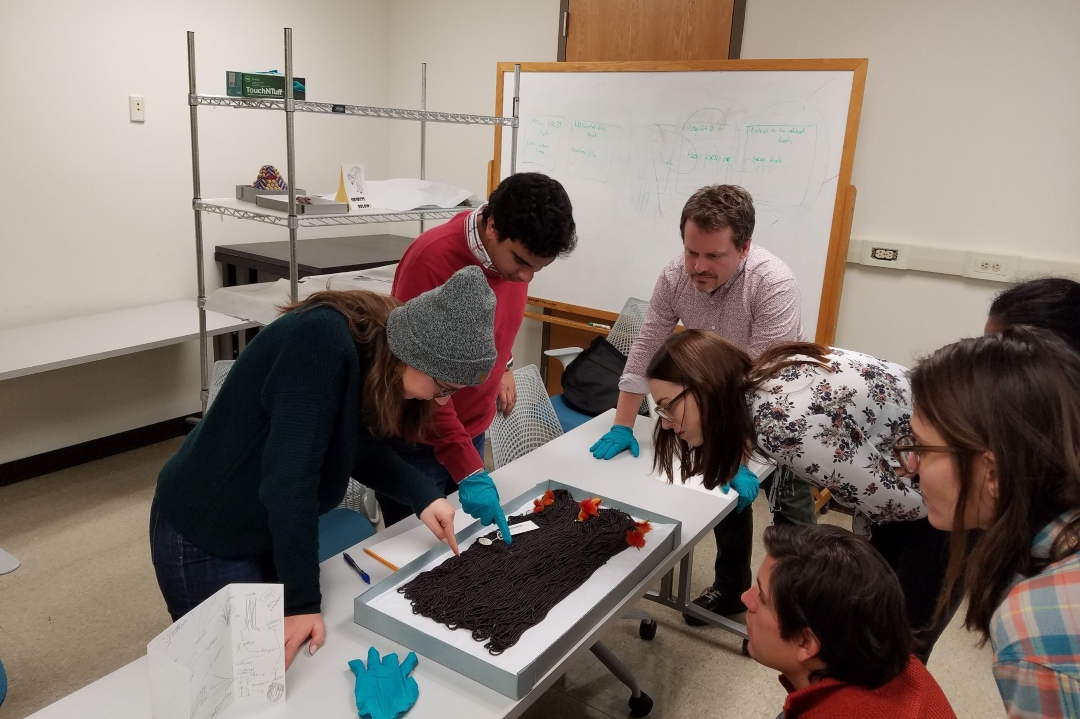 Students looking at sample