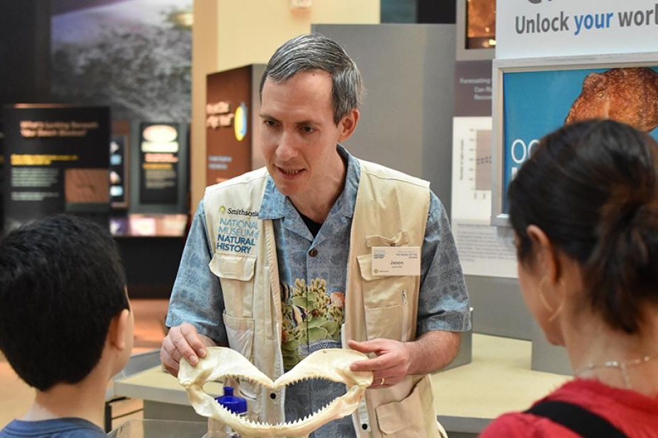 man presenting fossil in the Smithsonian