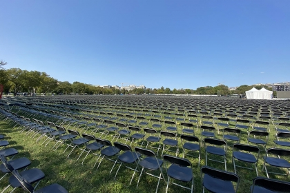 Rows and rows of empty folding chairs line the National Mall