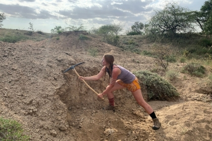 In order to minimize contamination from modern environmental conditions, CCAS senior Noelle Purcell digs beneath the surface of